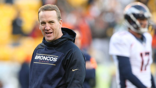 Denver Broncos quarterback Peyton Manning on the field before the game against the Pittsburgh Steelers at Heinz Field.