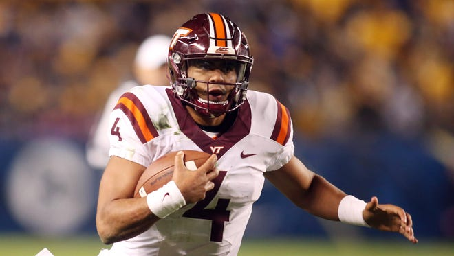 Virginia Tech quarterback Jerod Evans scrambles with the ball against Pittsburgh at Heinz Field.
