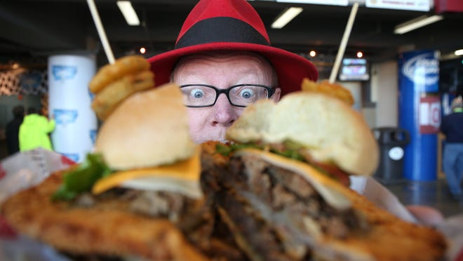 Des Moines Register sportswriter John Naughton recently took on the SlamWich at Wells Fargo Arena during the 2014-15 Iowa state girls' basketball tournament.