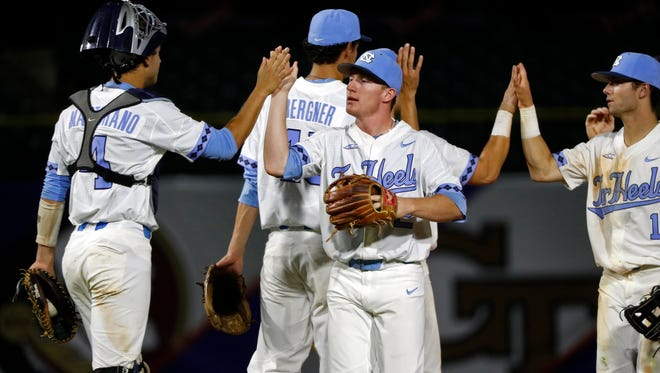 The Tar Heels celebrate after defeating Miami on Saturday.