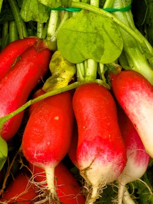 French breakfast radishes at the Bayview Farmer's Market in Langley, Wash., that are typical of many edibles that are eaten raw.