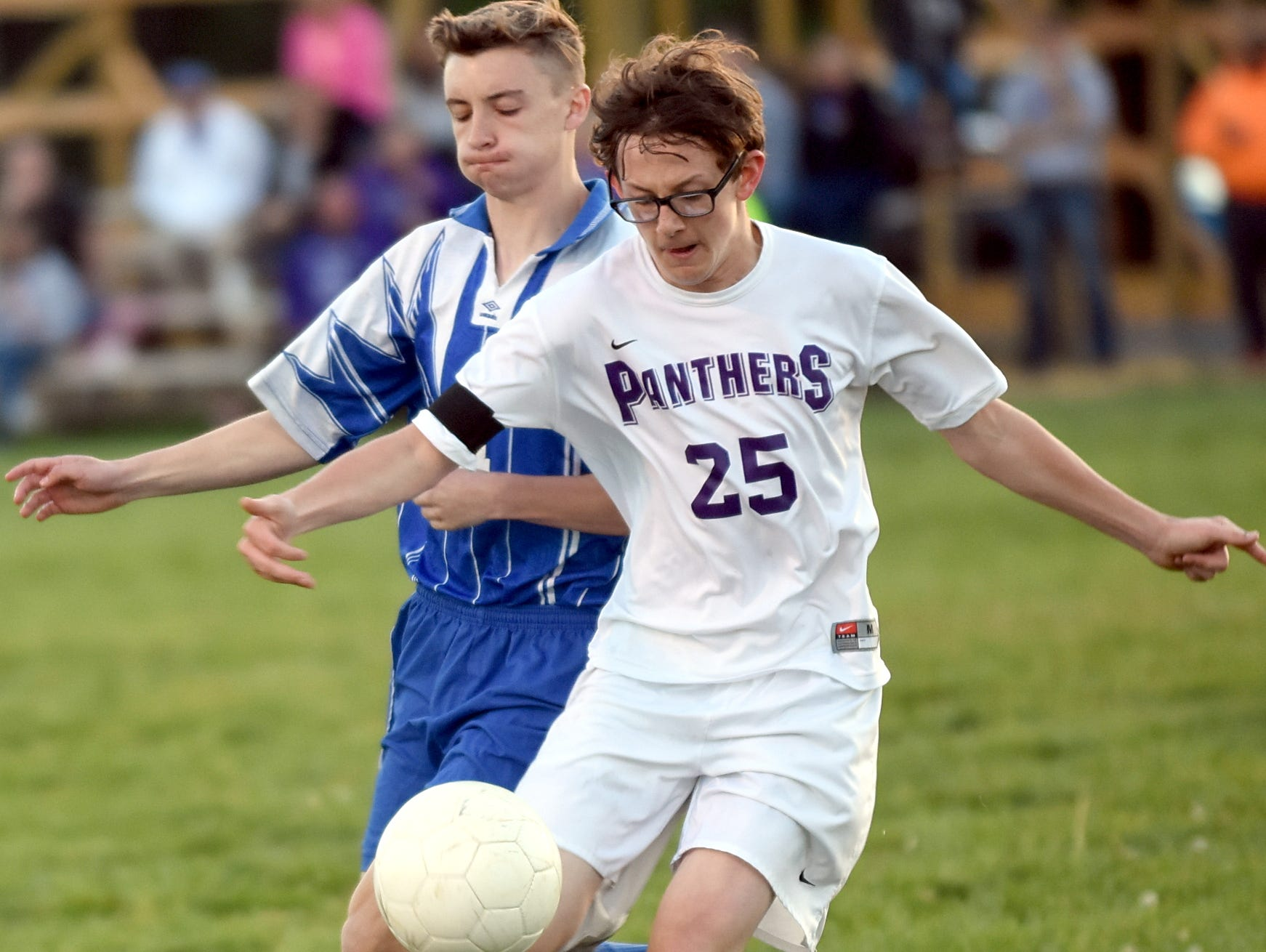 Portland High freshman Nathan Brown plays a first-half throw-in in front of White House sophomore Ethan Smith.