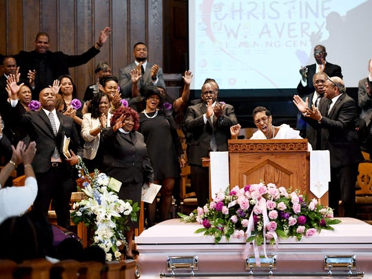 Kassandra Smith, mother of Erica Smith, celebrates the lives of her daughter and grandchildren at their funeral service at First Baptist Church of Asheville April 27, 2018.