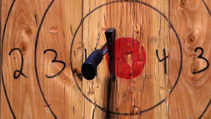 'Like darts on steroids': Ax-throwing has a bulls-eye on Des Moines, with 3 venues opening this summer