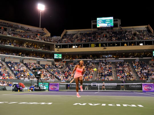 Serena Williams celebrates winning a point against Timea Bacsinszky, of Switzerland, during their match at the BNP Paribas Open tennis tournament, Wednesday, March 18, 2015, in Indian Wells, Calif.