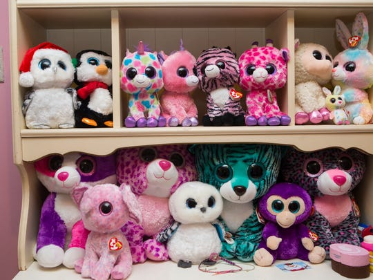 Beanie Boos are arranged on a shelf in the bedroom of Cindy Redmond.