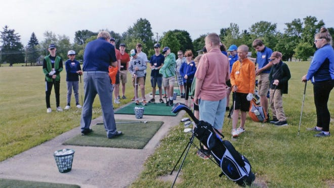 Golf professional Steve Grimes instructs junior golfers on the fundamentals of the grip and swing at the Heart of Ohio Junior Golf Association Camp held last week at the Miracle Driving Range in Marion. There were 22 juniors ranging in ages 9 to 16 who participated in the one-day event.