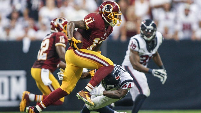 Washington Redskins wide receiver DeSean Jackson (11) makes a reception during the fourth quarter as Houston Texans cornerback Johnathan Joseph (24) attempts to make a tackle at NRG Stadium. The Texans defeated the Redskins 17-6.