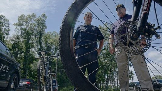 Westland resident Bill Mowder, right, an AmeriCorps veterans resource coordinator, and a Westland resident, and Westland Police Officer Jeff Kropodra with unclaimed bikes that will now go to area veterans.