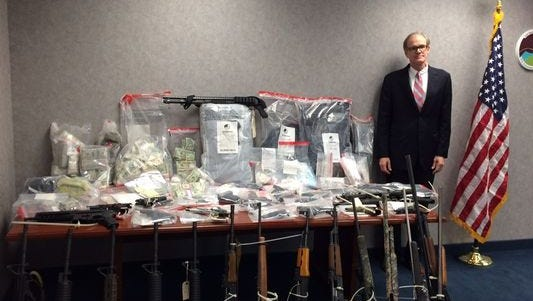 U.S. Attorney Bill Nettles stands by seized items during a cocaine investigation. (Photo: U.S. Attorneys Office)