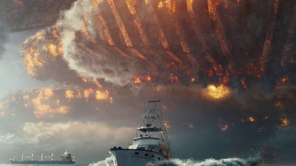 """A boat speeds away from an oncoming space ship in """"Independence Day: Resurgence."""""""