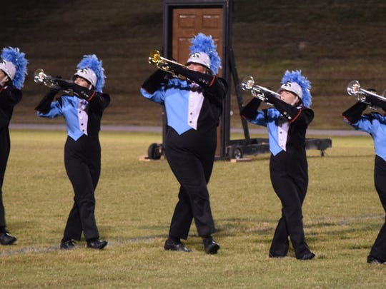 Members of the Band of Braves march in unison during their showcase performance at UCHS last Tuesday night. The B.O.B. had worked tirelessly to make sure every part of the routine was perfect.