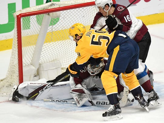 A shot by Nashville Predators defenseman Roman Josi (59) is blocked by Colorado Avalanche goaltender Andrew Hammond (35) as Colorado Avalanche defenseman Nikita Zadorov (16) reaches in during the second period in game 5 of the first round NHL Stanley Cup Playoffs at the Bridgestone Arena Friday, April 20, 2018, in Nashville, Tenn.