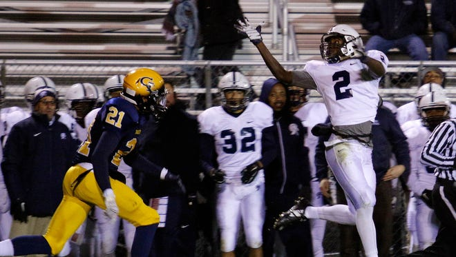 East Lansing's Kentre Patterson (2) catches a pass against Grand Ledge's Malek Adams Friday, Oct. 16, 2015, in Grand Ledge, Mich. Grand Ledge won 31-21.