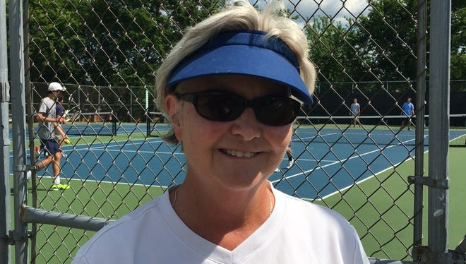Trinity girls tennis coach Elisa Bowden returned to the varsity team after last coaching it in 2001.