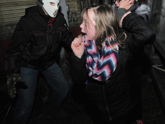 Jaiden Foreman, right, Nadia Kleinschmidt, both of Schofield, get frightened by Brandon Graefe at a haunted house at Wilke's Extra Sweet Acres in Wausau in October 2014. T'xer Zhon Kha/Daily Herald Media Jaiden Foreman, 10, right, Nadia Kleinschmidt, 7, both of Schofield, are startled by Brandon Graefe on Saturday night in a haunted house at Wilke's Extra Sweet Acres in Wausau.