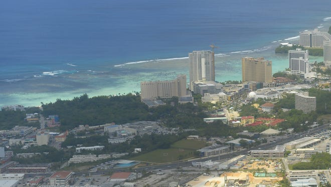 Tumon Bay is visible in this photograph taken from a Japan Airline flight above the island. Land next to the Hyatt Regency Guam has been purchased for about $34 million.