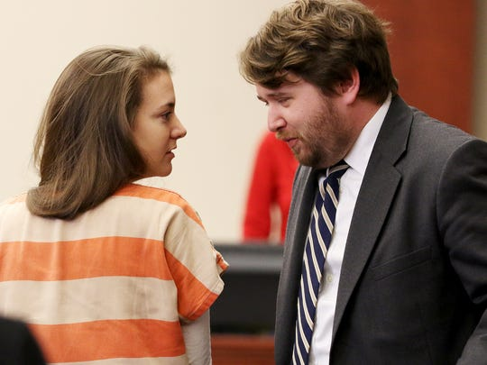 Shayna Hubers, left, talks with her attorney, Jeffrey Lawson Tuesday, Feb. 14, 2017. Hubers' second trial for the murder of Ryan Poston will start Jan. 16, 2018, Campbell County Circuit Judge Fred Stine ruled on Tuesday, more than four years after Ryan Poston was killed.