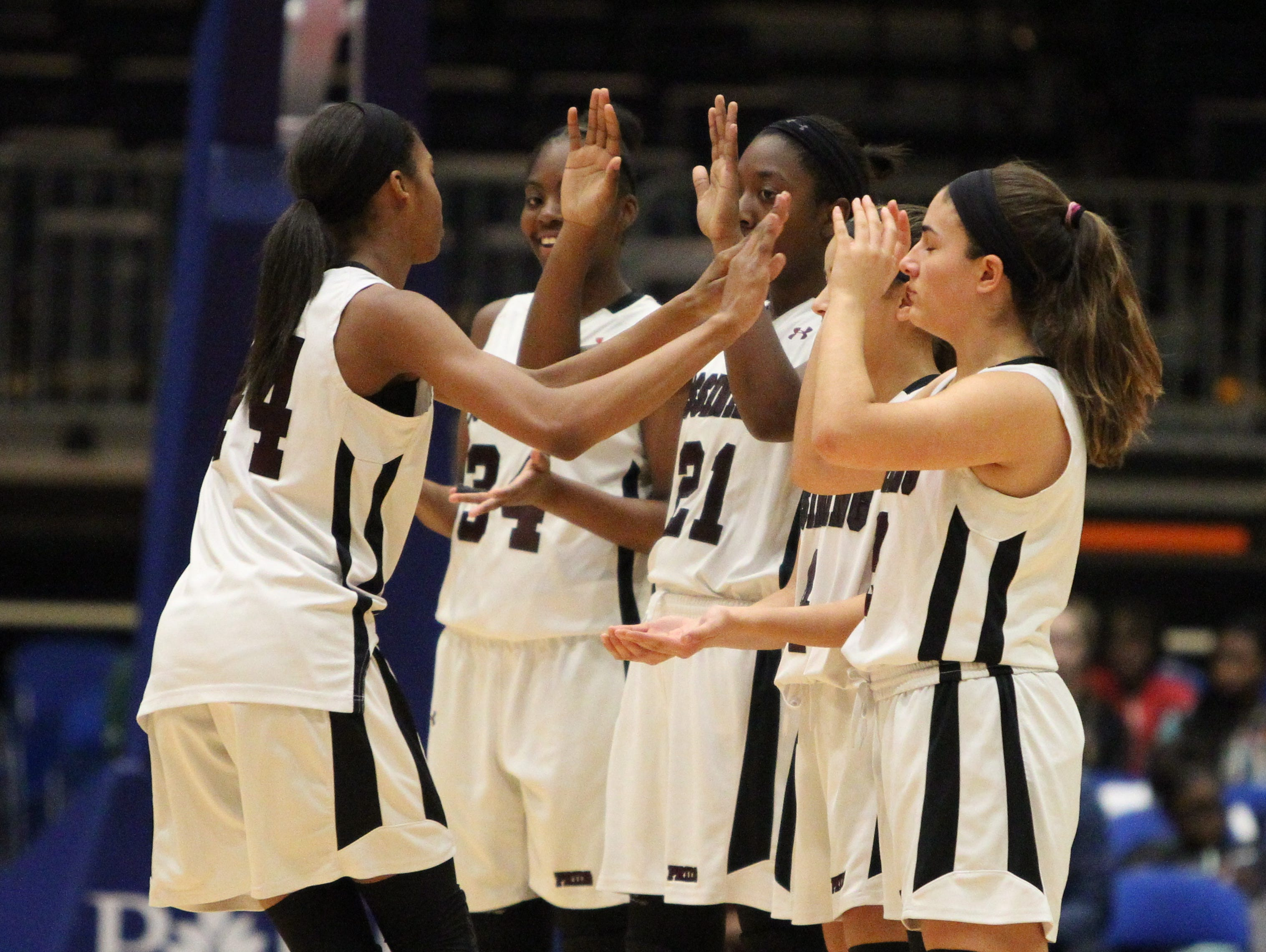 Ossining beat New Rochelle 86-54 in a Section 1 Class AA girls basketball semifinal at the Westchester County Center Feb. 25, 2016.