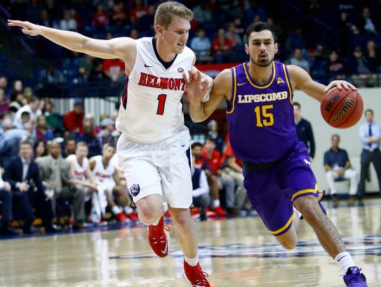 Lipscomb guard Andrew Fleming (15) drives against Belmont