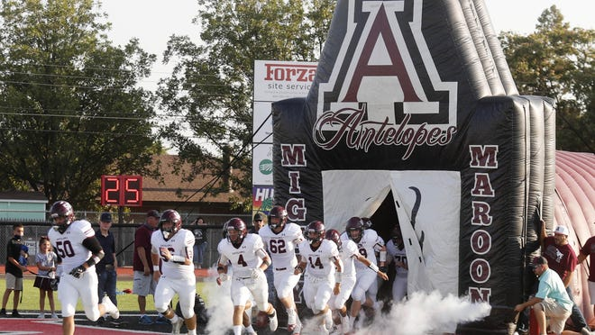 The Abernathy football team enters the field before the start of a non-district game Friday against Shallowater at Todd Field in Shallowater.