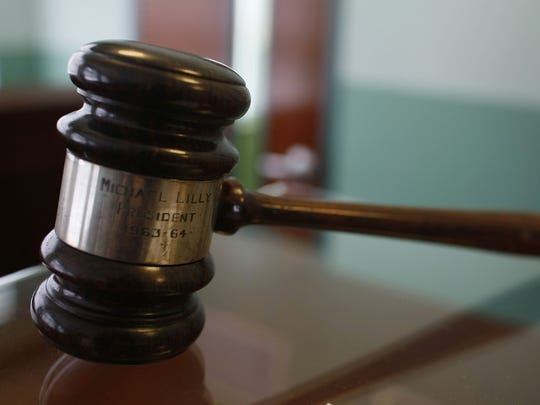 A gavel is seen in a courthouse.