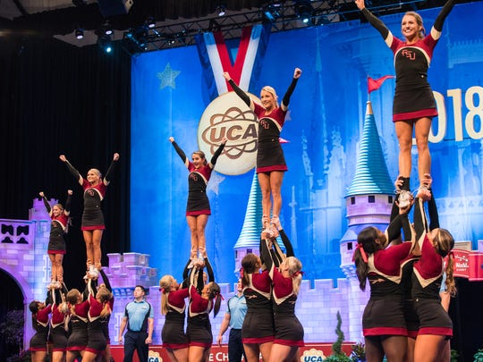 The Florida State All-Girl Cheerleader Team performs their routine at the UCA National Competition at the ESPN Wide World of Sports in Orlando, Florida on Sunday. They placed 11th in the finals.