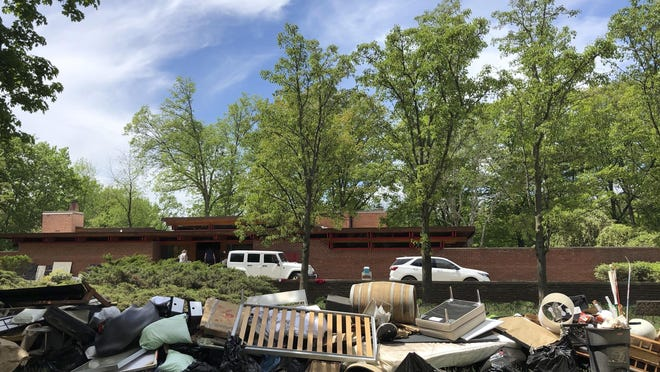 Piles of household debris line Valley Drive in Midland, Michigan, on Wednesday, May 27, 2020. The Michigan Dam Safety Task Force on Wednesday, Feb. 3, 2021 delayed sending the governor its final recommendations, which include increased monitoring of dams and other risk reduction measures.