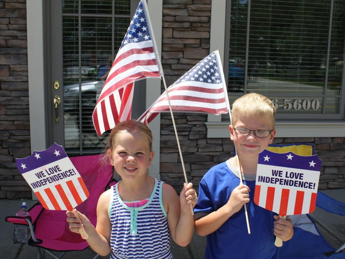 Ava and Isaac Vanderhoof of Independence had flags, fans and clothing that were all red, white and blue during the Independence Fourth of July Parade 2014.