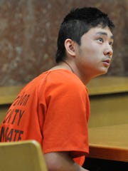 Dylan Yang, 15, of Wausau, appears for his preliminary hearing Thursday morning, March 12, 2015, at the Marathon County Circuit Court in Wausau. Yang is charged with first-degree reckless homicide in the death of 13-year-old Isaiah Powell on Feb. 27.