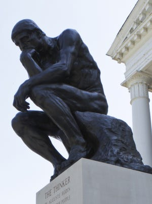 The Thinker statue in front of Grawemeyer Hall at the University of Louisville.
