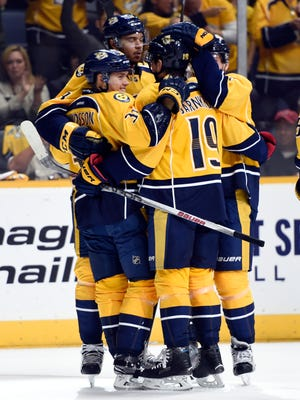 Predators congratulate right wing Viktor Arvidsson (38) after he scores his first NHL goal during the first period against the Hurricanes at Bridgestone Arena on Thursday, Oct. 8, 2015.