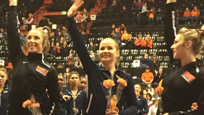 UCLA gymnast Madison Kocian, center, with OSU's Kaytianna McMillan, left, and Madeline Gardiner at Gill Coliseum on Jan. 28, 2017.