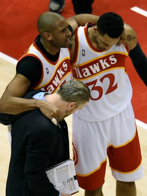 Atlanta Hawks center Al Horford (center) is helped after an apparent injury during the second half in game two of the Eastern Conference Finals of the NBA Playoffs against the Cleveland Cavaliers at Philips Arena.