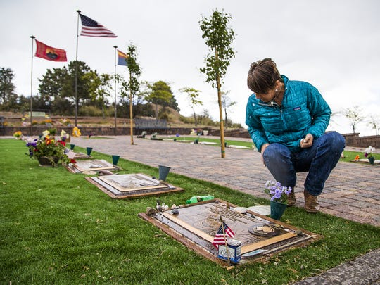 Amanda Marsh visits her husband's grave at the Arizona Pioneers' Home Cemetery in Prescott.