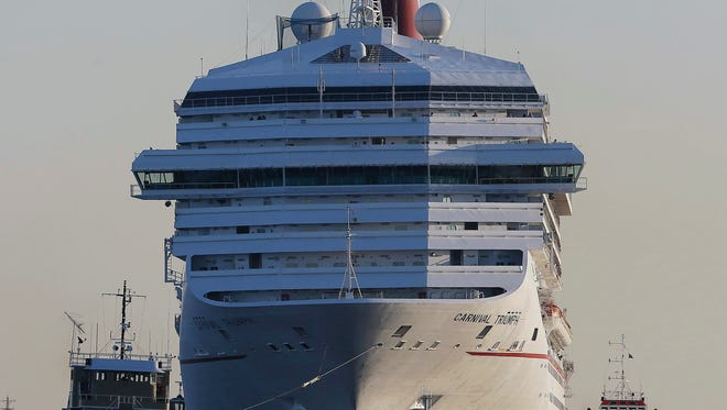 The Carnival Triumph is towed into Mobile Bay on Thursday, Feb. 14, 2013.