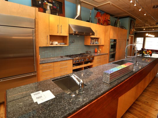The Morgensterns have a large open kitchen area with stainless steel appliances.