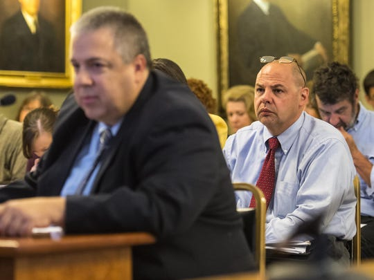 Department of Corrections Commissioner Andy Pallito, right, listens as Defender General Matthew Valerio, left, testifies before the Joint Legislative Oversight Committee in Montpelier on Wednesday, about the deaths this year of three inmates in Department of Corrections custody.