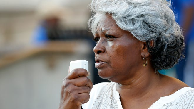 Audrey DuBose, mother of Sam DuBose, leads supporters in a prayer on the courthouse steps during the Jericho March for Justice at the Hamilton County Courthouse in downtown Cincinnati on Monday, June 19, 2017. The Jericho March walked seven laps around the courthouse as a symbolic gesture of bringing down injustice, calling back to the biblical Walls of Jericho.