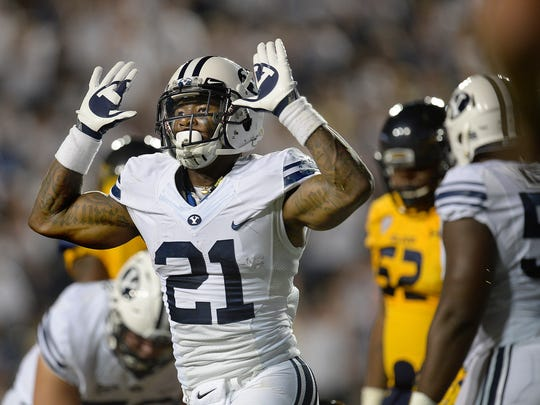 BYU running back Jamaal Williams celebrates after scoring
