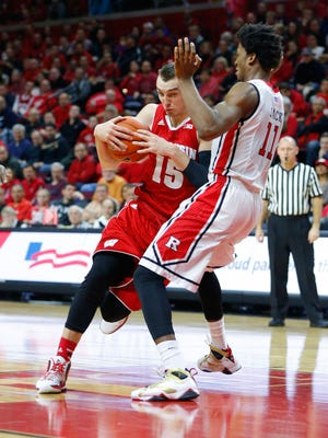 Rutgers Scarlet Knights forward/center Kadeem Jack (11) defends Wisconsin Badgers forward Sam Dekker (15) during the second half at Louis Brown Athletic Center.