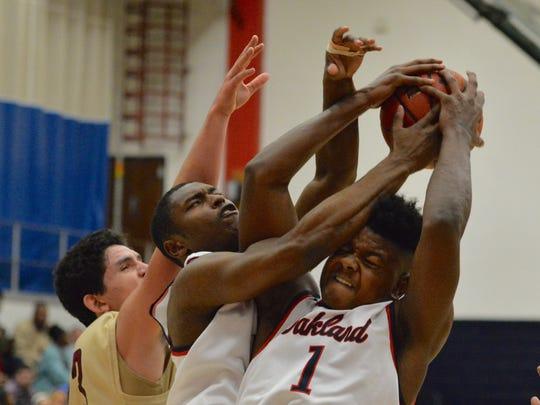 Oakland's Tre Jones (1) battles teammate JaCoby Stevens