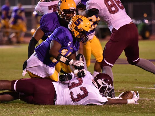 Smyrna's Nick Okeke brings down Dobyns Bennet's Keyo Taylor during Friday's 6A playoff game.