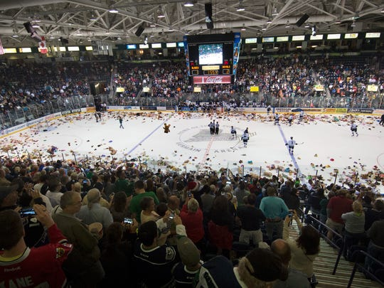 Teddy Bears litter the ice rink during the Everblades game, Saturday (12/12/15) following the annual Teddy Bears Toss at Germain Arena. The Teddy Bears will be distributed to local children charities Monday by EWverblades players.