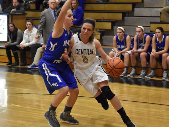 Central Magnet's Sydney Smith drives around a Macon County defender Tuesday.