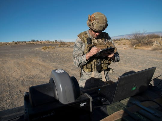 Senior Airman Matt Maurer, 49th Civil Engineer Squadron explosive ordnance disposal technician, takes notes during an EOD operation Jan. 6, 2017 at Holloman Air Force Base, N.M. Holloman's EOD unit was alerted by the U.S. Border Patrol about the potential unexploded ordnance.