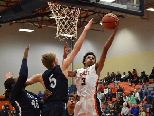 Blackman's Donovan Sims lays one up against Siegel's