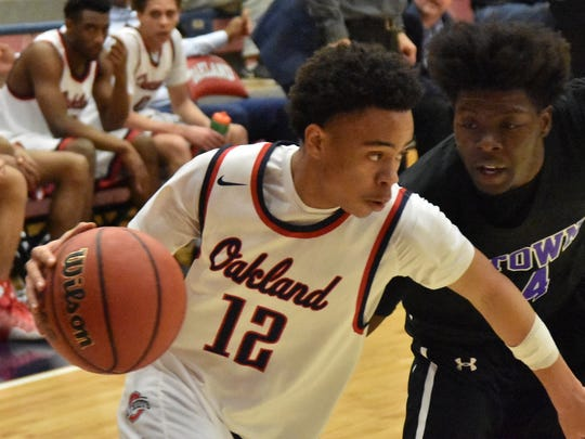Oakland's Ray Tyler drives the baseline during Saturday's win over Columbia.