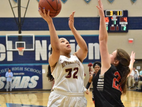 Riverdale's Brinae Alexander (32) goes up for a shot