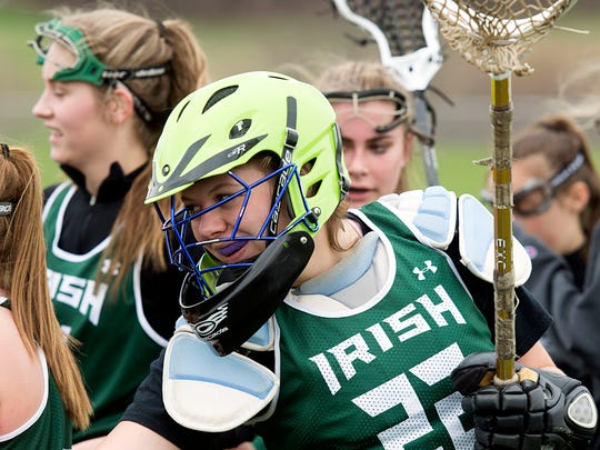 York Catholic goalie Kristen Lake celebrates with teammates after the the team's win, Monday, April 3, 2017. The Irish beat the Mustangs, 14-6.